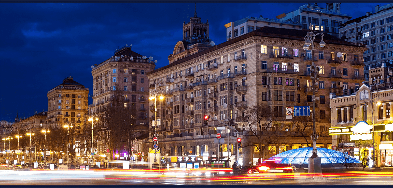 SURGe project header - nighttime view of Ukraine buildings